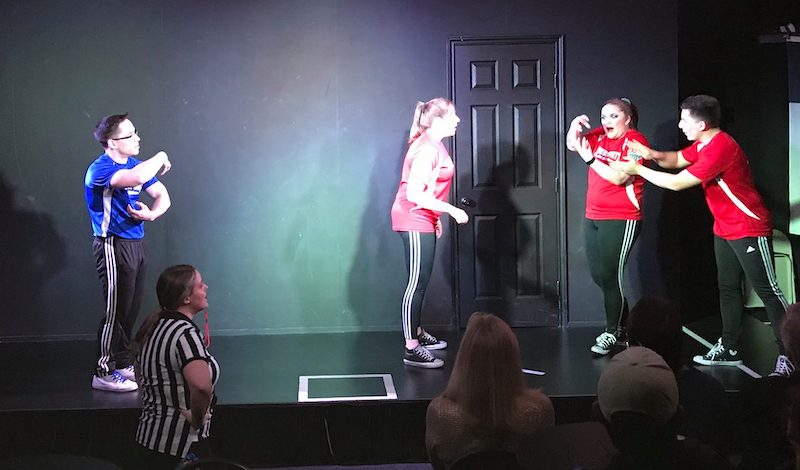 Michael, Morgan, Bailey, and Eric perform a scene at ComedySportz San Antonio
